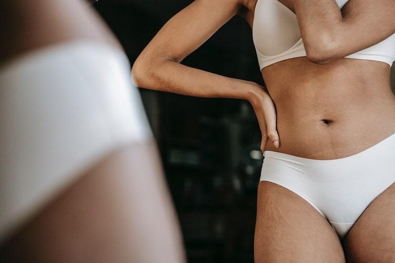 Woman in underwear against a mirror