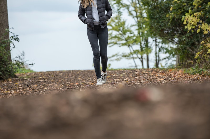 A woman walking, showing an example of a way to exercise after plastic surgery