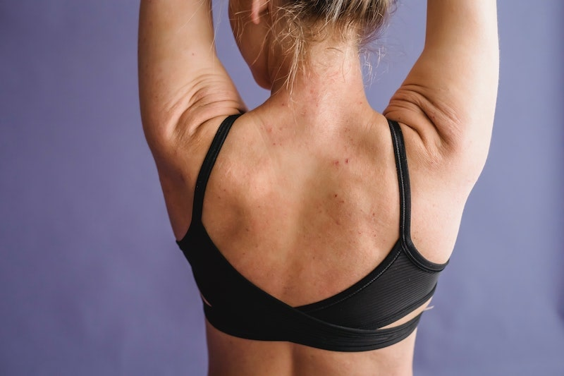 A woman wearing a supportive bra